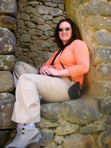 Sra. Schwarz inside a window opening at the Ollantaytambo Inca Ruins, Cusco.