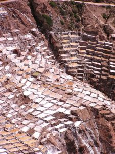 Shallow pools of salty water at the Salt Mines of Maras (Salinas de Maras), Cusco.