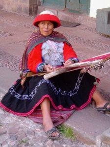 A woman weaving outside the Museo Inka, Cusco.